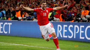 3-1 Wales. That's all Vokes!